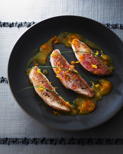 Fried red mullet with orange sauce