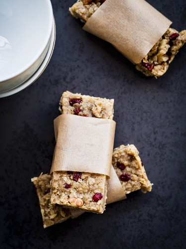 Homemade peanut butter power protein bars with oats, honey, cranberries and nuts.