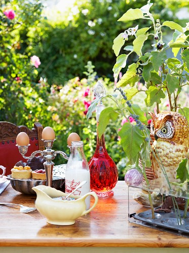 Table in garden set with candelabra used as eggcup