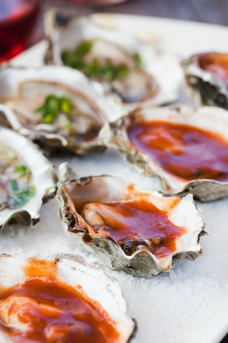 Barbecue Oysters and Fresh Oysters on the Half Shell
