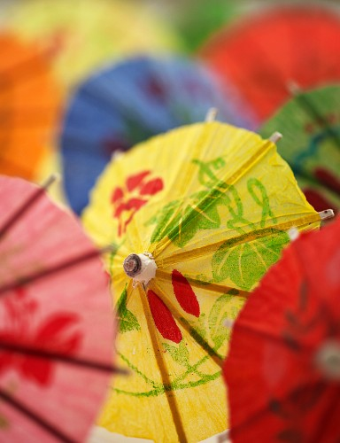 Several colourful cocktail umbrellas (close-up)