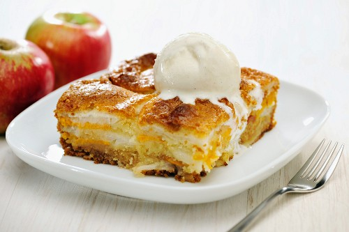 Carolina Cobbler; Delicious Souffle made of Layers of Apples and Sweet Potatoes, covered with a Dough (without eggs), pint of Vanilla Ice Cream on Top