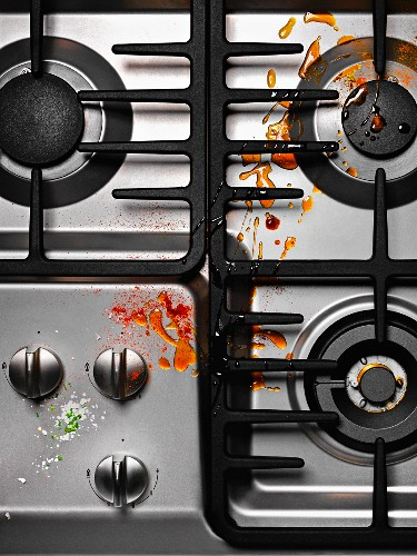 A dirty gas hob (view from above)