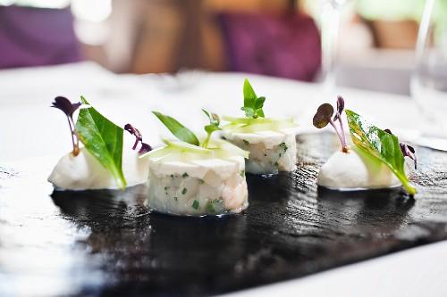 King mackerel tartare with crème fraîche sorbet in a restaurant