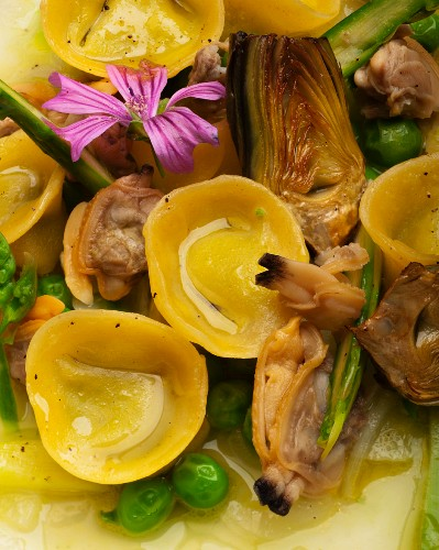 Cappelletti pasta with mussels, artichokes and peas (detail)