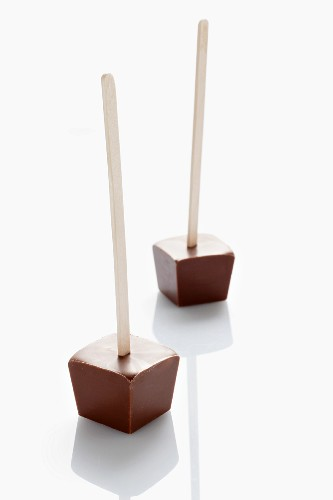 Cubes of drinking chocolate on wooden sticks