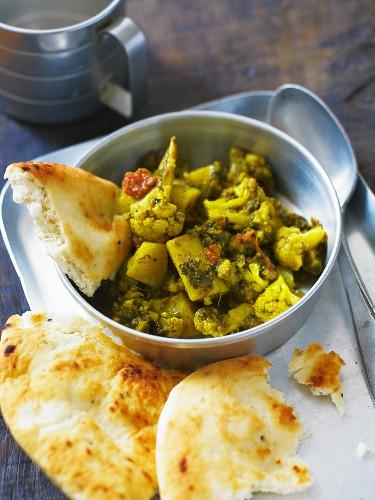Aloo gobi (potatoes with cauliflower, North India) with flatbread