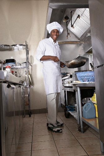 An African chef in a commercial kitchen