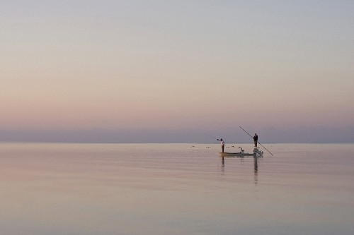 Two Men Fishing in Boat on Calm Water, Florida Keys, USA