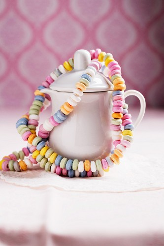 Colourful candy bracelets hanging on a milk jug