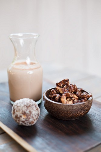 Cashew nuts with cocoa powder, almond milk and coconut and date balls
