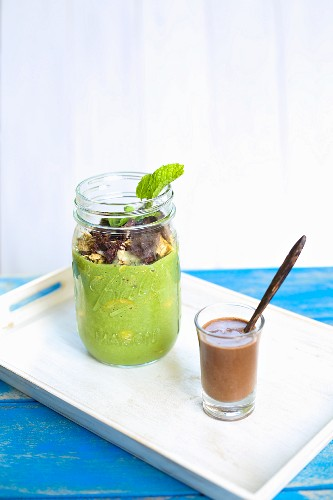 Breakfast parfait with pumpkin seed milk and cocoa nibs with chocolate sauce