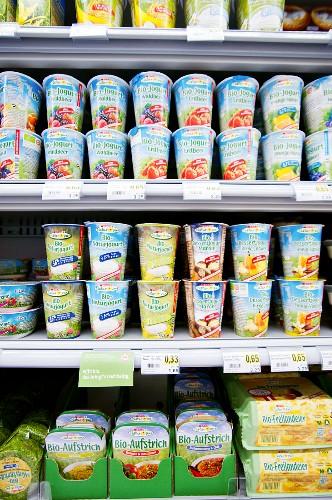 Organic produce on a refrigerated shelf