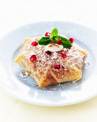 Pastilla with rabbit and pomegranate seeds