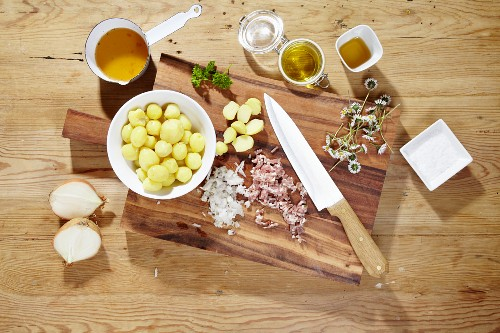 Ingredients for making warm potato salad with daisies