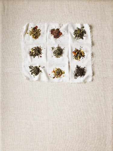 Various types of teas on a white cloth