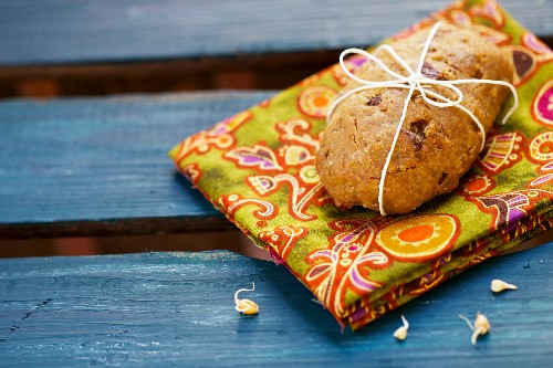 A rolls with wheatgerm seeds on a colourful napkin
