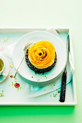 A mango tartlet with a chocolate base and plum wine cream