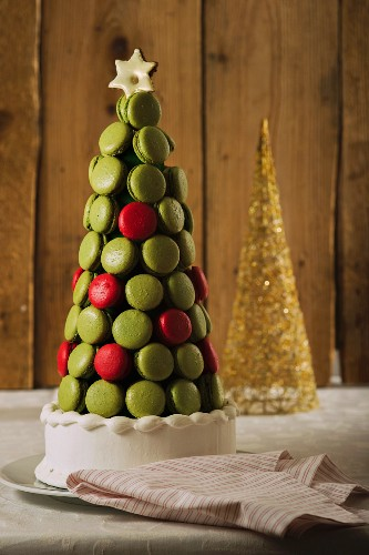 A Christmas cake decorated with redcurrant and pistachio macaroons