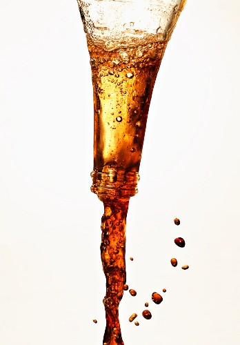 A drink being poured out of a bottle