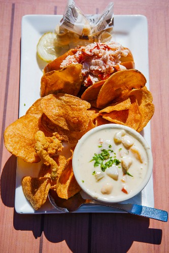 Lobster roll with clam chowder and homemade potato crisps