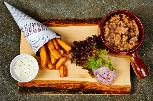 Carbonade flamande (Belgian sweet and sour beef and onion stew made with beer) with chips and mayonnaise