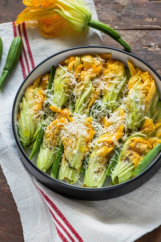 Stuffed courgette flowers in a baking dish