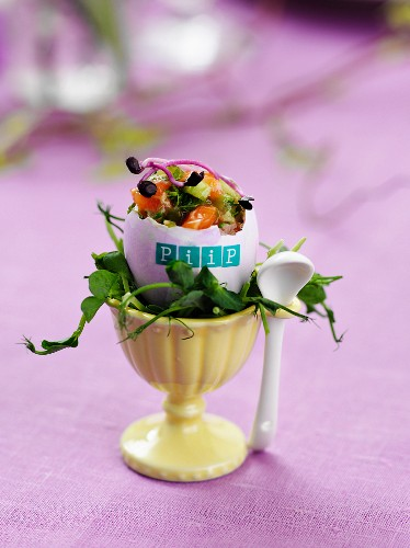 Salmon salad served in a labelled egg shell in an egg cup