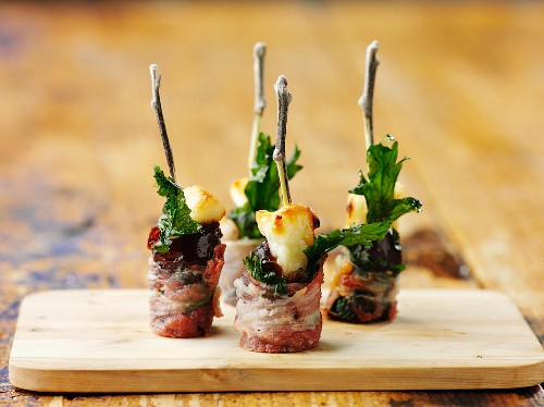 Plums wrapped in bacon