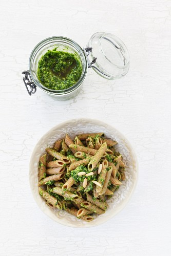 Wholemeal penne pasta with wild garlic pesto and pine nuts