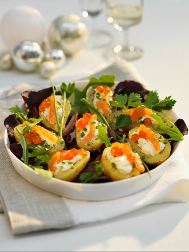 Potato salad with smoked salmon and salmon caviar for Christmas