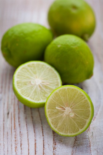 Limes on a lightwooden surface