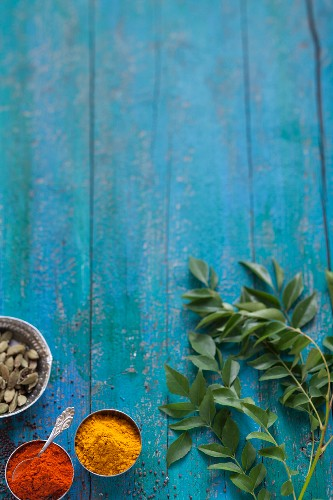 Indian spices on a turquoise blue wooden table