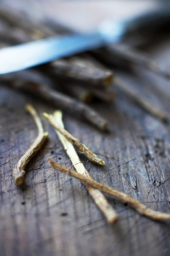 Liquorice sticks on a wooden background
