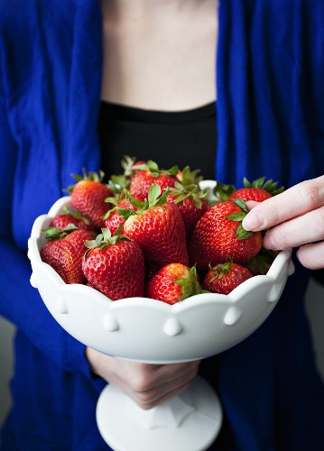 Fresh strawberries in a porcelain bowl