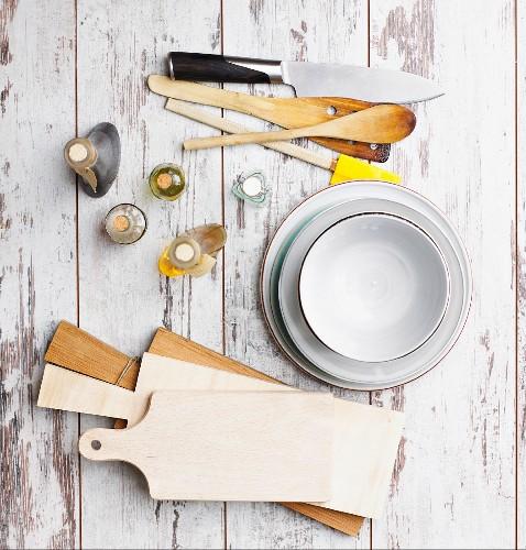 Various kitchen utensils, vinegar and oil