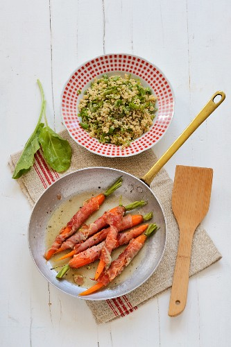 Carrots wrapped in ham served with couscous with sorrell