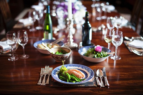 Salmon with green beans on a festively laid table