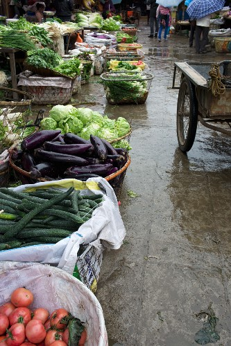 Baskets of vegetables at a market in Lijiang, China