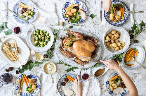 Christmas dinner with turkey, parsnips, Brussels sprouts, potatoes, carrots, gravy and cranberry sauce