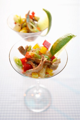 Exotic vegetable salad with turkey served in a cocktail glass