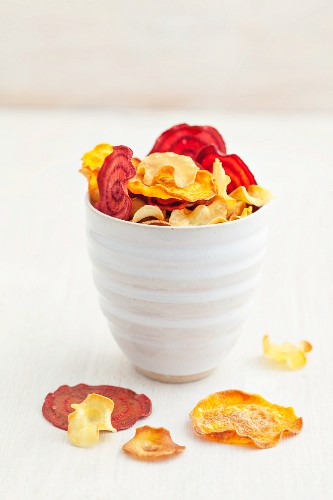 Vegetable crisps in a white ceramic cup