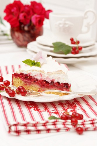 A slice of redcurrant tart with meringue