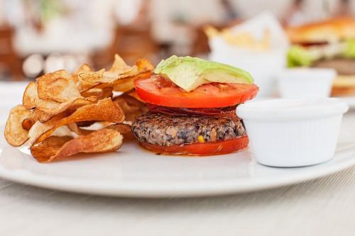A quinoa burger with tomato and avocado in a cafe in South Beach, Miami, Florida