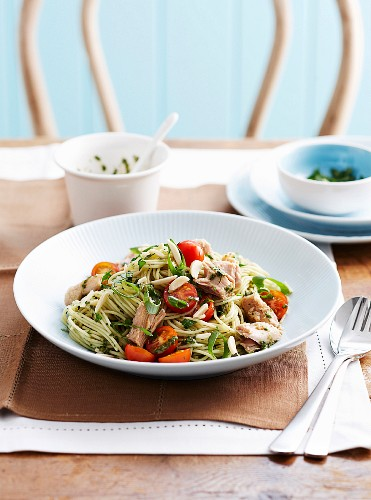 Spaghetti with salsa verde, tuna, tomatoes and spring onions