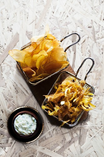 Fried potatoes in different shapes with a quark dip
