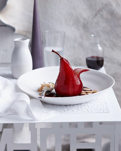A red wine pear with flaked almonds