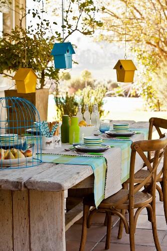 Bird houses hung over set table
