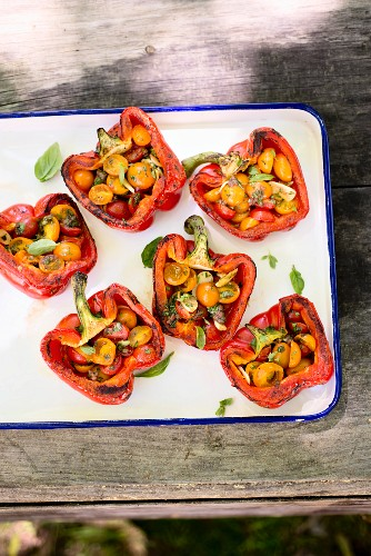 Grilled peppers stuffed with tomato salad