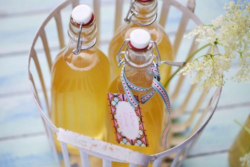 Elderflower syrup in a basket